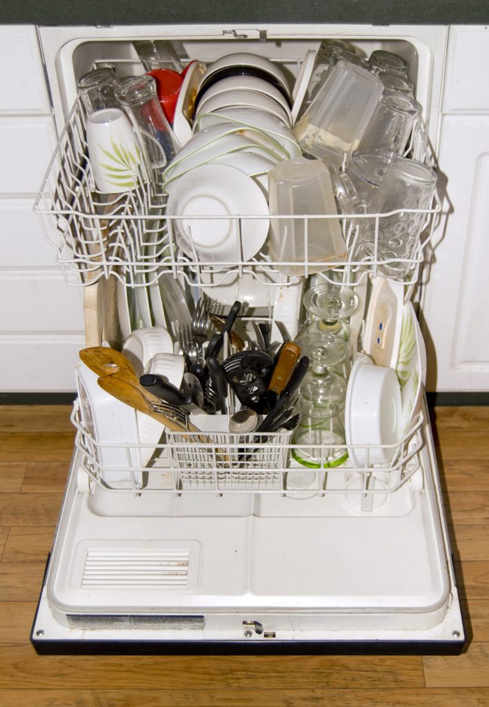 A full dishwasher - ready to go. It is all loaded up with dirty dishes.